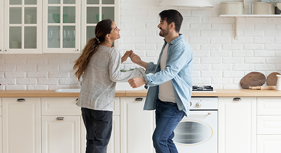 Couple dancing in house