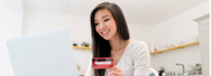 woman-with-credit-card-at-computer-s